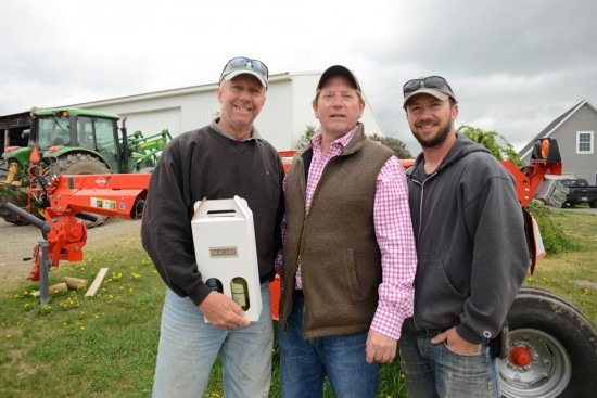 Colin with Dan & Keith Gibson and a gift from the Macari family vineyard