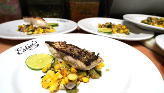 Striped Bass over sweet corn and wheat berry salad
