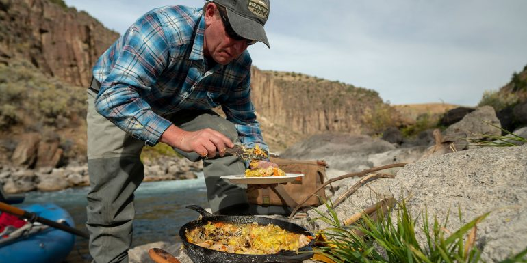Colin Ambrose is serving his cornbread crusted chicken pot pie, cooked and enjoyed by the Teton River